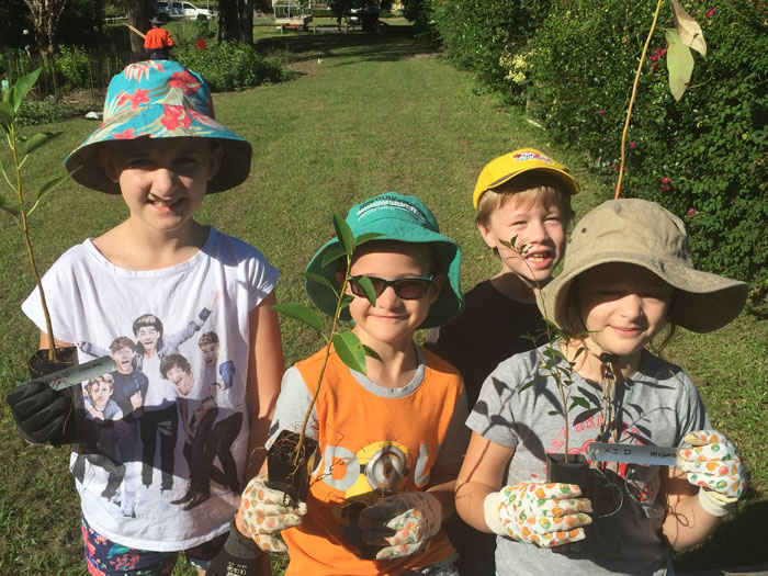 Albany Hills State School students with their very own trees to plant