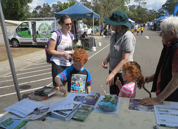 Dawn Road Reserve Bushcare patron Janet Mangan speaks to Albany Hills State School fete-goers