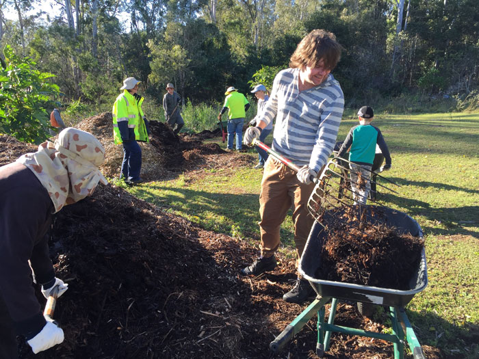 Wild BNE's Christian Perrin pitches in with Dawn Road Reserve Bushcare's Janet Mangan to help spread some of the mulch around the edge of the revegetation site. Pic: Trina McLellan